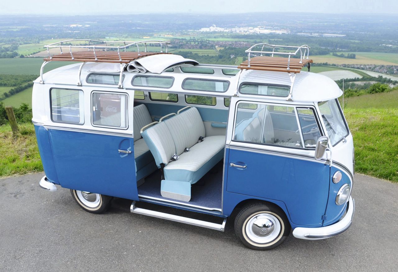 19 Blue VW Buses and Campers